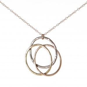 Celtic knot made from acoustic and electric guitar string on a rose gold chain and white background