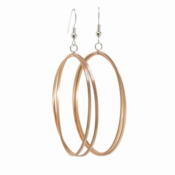 large guitar string hoop earrings with silver hooks on a white background