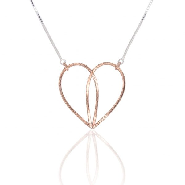 guitar string heart pendant suspended on a silver box chain with reflection
