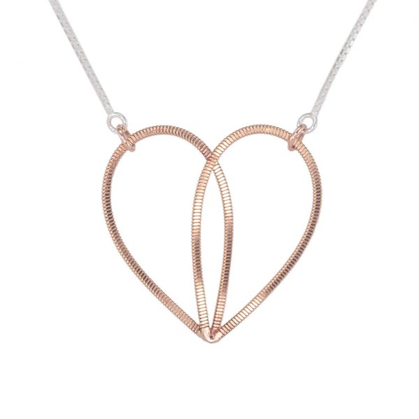 guitar string heart pendant suspended on a silver box chain
