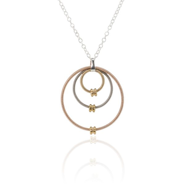 guitar string necklace made from three concentric circles of acoustic and electric guitar string on a silver chain with reflection