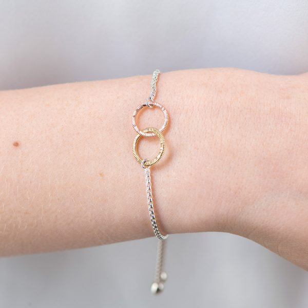 silver bracelet with interconnected circles of guitar string on model