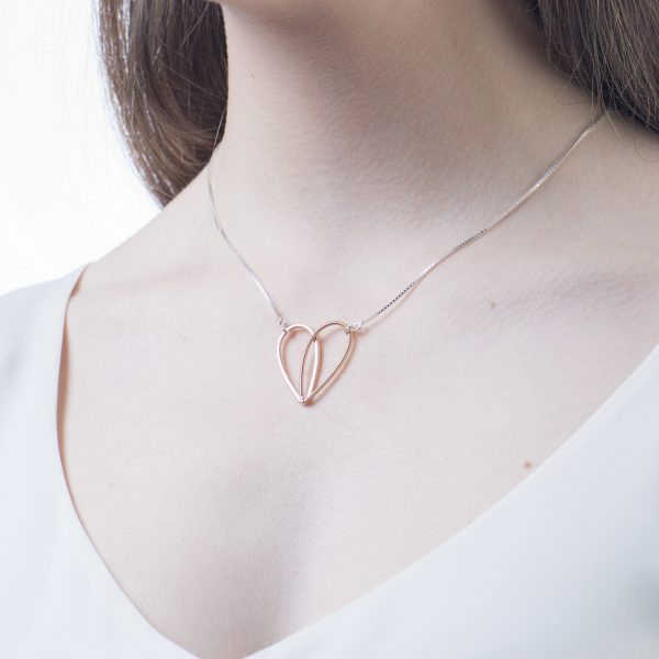 guitar string heart pendant on model with white background