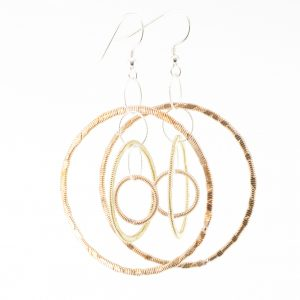 guitar string inter-hanging dangle hoop earrings on a white background