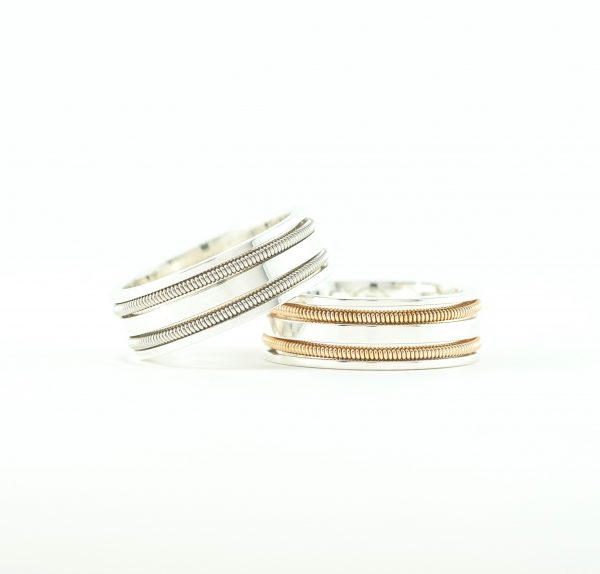 two silver rings with double inlaid guitar strings