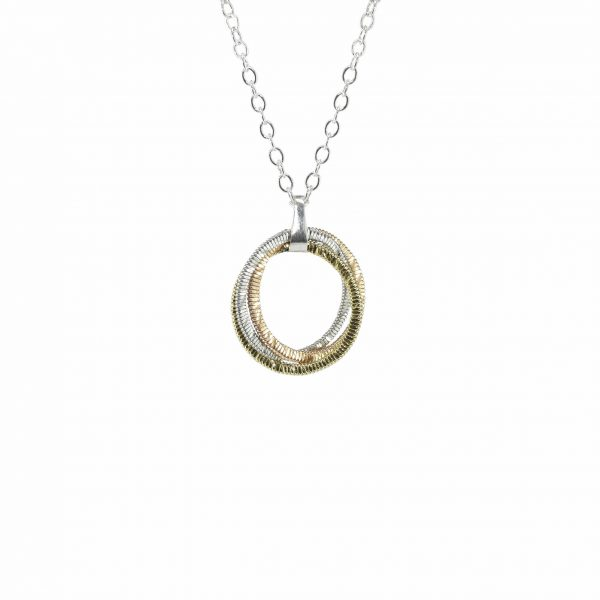 tri-metalic guitar string circular pendant on a silver chain suspended in a white background