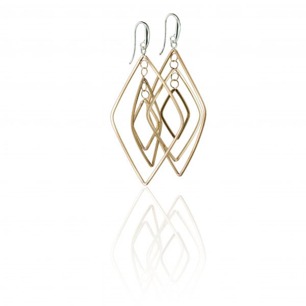 floating diamond-shaped dangling guitar string earrings with silver ear hooks on a white background with reflection