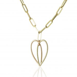 hanging two-toned acoustic guitar string heart pendant on a 14K gold long link chain on a white background with reflection